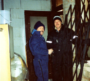 "Det. Eddy Wiora (left) and me putting burglar bars on my informant's Korean ""whore house"" after a violent home-invasion robbery."
